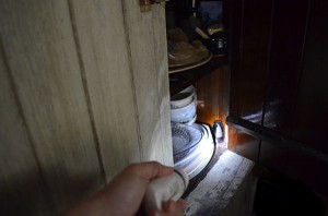 photo showing using a flashlight to find misplaced items